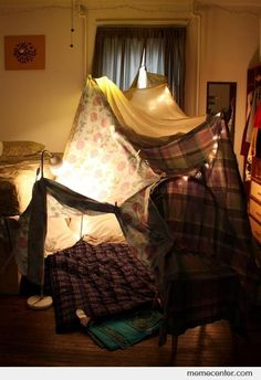 Forts are best built out of dining room chairs, couch cushions, and blankets. March Break activity #4