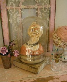 Just had a thought- if you used a bust like this as a wig stand placed a glass cloche over it as pictured, the cloche would protect the wig while you weren't wearing it :)