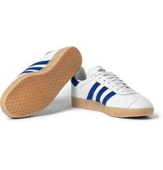 Succeeding the 'OG' model in the '70s, adidas Originals released its second 'Gazelle' to give fans the option of a fuller profile. This white leather pair is punctuated with vibrant blue details for an athletic look. The padded cuffs and durable rubber soles ensure lasting comfort. Keep yours pristine with a good leather cleaner.