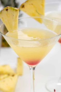 Have a Hawaiian Martini to feel like you're at the beach! This martini recipe has all the flavors of Hawaii: pineapple, orange, and coconut! I really wish I was in Hawaii this summer, but since I can' Cocktails For Parties, Party Drinks, Summer Drinks, Fun Drinks, Mixed Drinks, Summer Martinis, Alcoholic Drinks, Popular Cocktails, Holiday Drinks