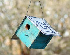 DIY Bird House. I also saw house shaped ones and ones with rounded tops with bent plates