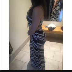 Black and white print cut out maxi dress Black and white print cut out in the back and twist in the front . Never worn Dresses Maxi
