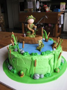 """Fishing Birthday Cake - 9"""" round cake with buttercream icing. Fondant fisherman, boat, and other decorations. Fish is gum paste. Thank you for the inspiration to all of the people who made fishing cakes on here! :)"""