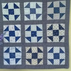 My doll quilt I made with civil war repro fabric in 2005.