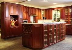 Versatile and Intense!  Madison Cherry cabinets are solid wood, ready to assemble cabinets that feature a rich cherry stain.  Matching stained boxes and shelves, Madison Cherry provides standard high-end features such as: all-wood construction, concealed hinges and soft closures. Rich and classic, Madison Cherry will transform any space into a brilliant and welcoming atmosphere. Ready To Assemble Cabinets, Cherry Kitchen, Concealed Hinges, Cherry Cabinets, Stylish Kitchen, Quartz Countertops, Wood Construction, Liquor Cabinet, Solid Wood