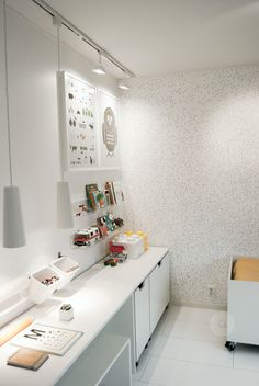 Love the desk, shelving & lighting idea for a kids playroom ... this room is too white for kids though!