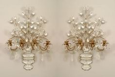 Pair of French Art Deco (Bagues) gilt metal and rock crystal 4 arm wall sconces with a spray of flowers emanating from an urn base with a carved and shaped design