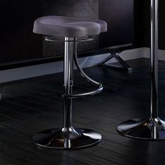 Sit down at your kitchen counter or in-home bar with this adjustable swivel bar stool that turns 350 degrees. This sleek stool has cushy seat padding filled with foam and a swirling foot bar that adds a touch of style while keeping you comfortable.
