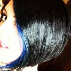 Natural Black hair with electric blue streaks: After midnight manic panic. Asymmetric Bob hairstyle.