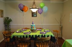 Party table. A green paper table cloth was cut out to give the look of dripping slime. The excess pieces were used to decorate windows and party tables. Super easy and very cute! Table was set with vintage Goosebumps cups and napkins and then matched with coordinating plates.