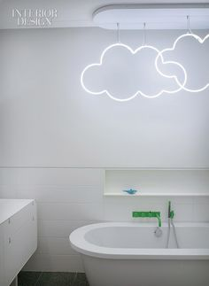 So much fun. With all the money you save on a simple white bathroom, you can splurge it on neon clouds!