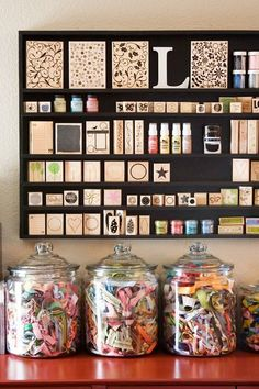 (Jenni) I love the how the dark shelving makes all the stamps pop and super easy to see. #SewingRoom #CraftRoom #Storage