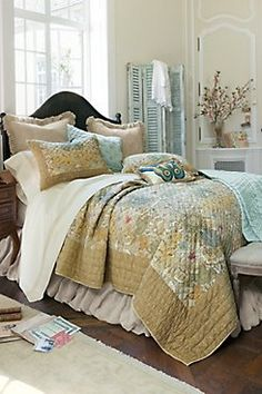 Palermo Quilt Inspired by a vintage Italian textile, our Palermo quilt is landscaped with a lush floral in sun-weathered hues of aqua, rose, ochre, gold and cream for the pati