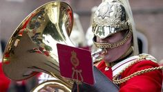 Prince George christening...Royal Life Guards Band performs in the streets of London