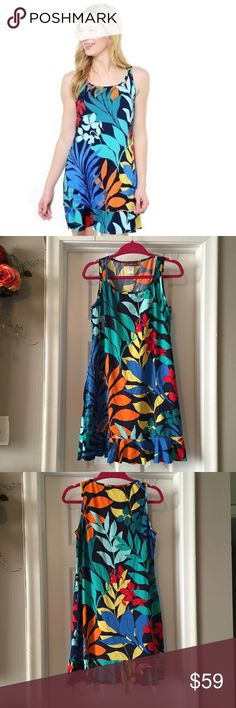 Tommy Bahama Spa Dress Wear this tank dress as a swimsuit cover up or just around the beach side town. The colorful print will sure catch some attention. Two side pockets & ruffle hem. 80% nylon, 20% spandex. Don't forget to shop my closet for a bundle discount! Tommy Bahama Dresses