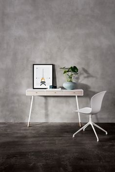 Console table and white chair on grey background
