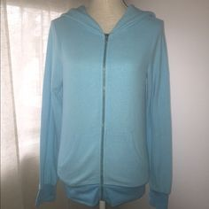 NWOT Wildfox Blue Track Jacket zip-up Hoodie NWOT Wildfox Couture blue track jacket zip-up hoodie. There is the WF horse emblem on the hood. Never washed/dried. No stains/holes. Size Small. Any questions please ask prior to purchasing.  No Trades Wildfox Tops Sweatshirts & Hoodies