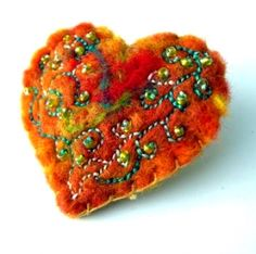 needle felted brooch. I'd love to try something like this but a Sacred Heart design. Love the stitching too.