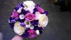 Wedding design with rich purples, pinks and creams.