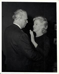 Marilyn dancing with Jack Warner at the press conference announcing a distribution agreement between Marilyn Monroe Productions and Warner Bros for The Prince and The Showgirl, 1 March 1956.