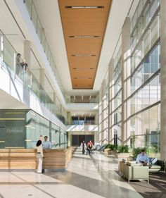 The atrium offers convenient registration kiosks built into the reception desk and two distinct wayfinding paths to either the acute care tower elevator bank or WISH tower elevator bank. Architect: HDR + Corgan, © 2014 Andrew Pogue.