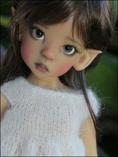 Young gray eyed fairy doll. Anyone know the sculptor?