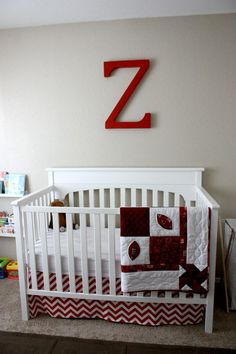 nursery with red, cream & neutral colors