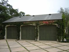 Wood Stained Garage Door by Carriage House available At www.automaticdoorspecialists.com