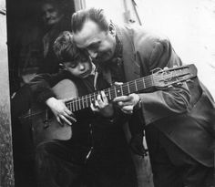 Django Reinhardt. With child. Me? I'm drinking coffee.