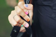 I have done something similar with hot pink, black and white. Each nail was different. Now Sally Hansen has a nail art pen!http://www.sallyhansen.com/products/nails/nail-color/nail-art-pen