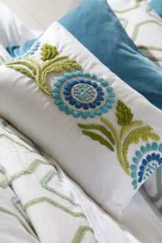 The embroided Suzani lumbar pillow features impeccable craftsmanship with a fanciful embroidered design. Find more beautifully stitched pillows at Ethan Allen. Cushion Embroidery, Hand Embroidery Art, Hand Embroidery Videos, Embroidery Suits Design, Embroidery Flowers Pattern, Embroidery Techniques, Embroidery Stitches, Diy Pillows, Decorative Pillows