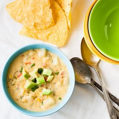Chili Corn Chowder - butter, cumin, oregano, chili in adobo, onion, red bell pepper, garlic, flour (4 cups), half and half (4 cups), chicken broth (4 cups), salt, russet potatos, white cheddar, pepper jack, hominy (1 can), cream corn (1 can), cilantro, 1 avocado, lime wedges