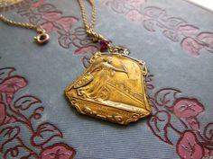 "Antique 1911 ""Exposition de Charleroi"" Gymnastics Festival Medal on Gold Chain with Garnets. $65.00, via Etsy."