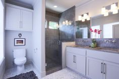 Master bath with 2 under mount sinks and Kohler off the wall faucets. The concrete was carried over into the master bath to create a walk in...
