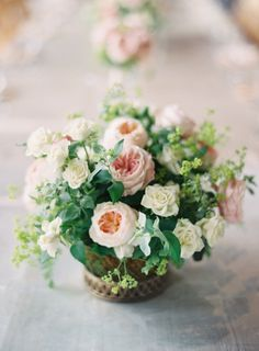 Peach peonies and ivory roses: http://www.stylemepretty.com/2013/12/02/st-louis-garden-wedding-from-clary-photo/   Photography: Clary Photo - http://www.claryphoto.com/