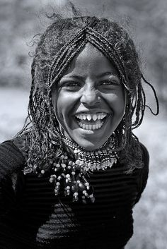 Afar Tribe Girl With Sharpened Teeth laughing, , Danakil, Ethiopia.... Photo taken by Eric Lafforgue.