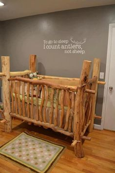 love this rustic wood crib, and the wall decal is a perfect compliment!