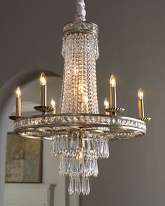 """""""Camella"""" Chandelier This stylish chandelier artfully juxtaposes modern shapes and materials with elegant, hand-cut European crystals for breathtaking results. Wrought iron frame has an """"Old Silver"""" finish."""