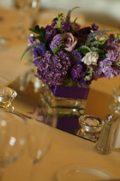 Like the small purple arrangement on the mirror with candles