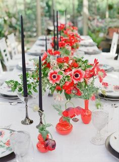 Anemone wedding centerpieces - bold, floral wedding centerpiece - Read more red wedding dress ideas on WeddingWire! {Blue Jasmine}