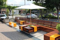 (parklet - Pesquisa Google) I really love how they added the bold Color elements! Suggests movement also.