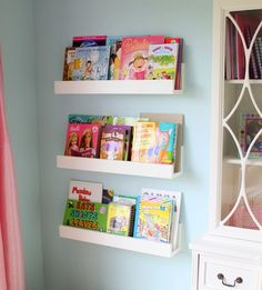 How-to make wall hanging bookshelves.  These are great.  They would fit behind the door in the den and give me a place for books and magazines.  Found on:  justagirlblog.com/diy-bookshelves/