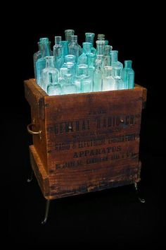 Blue bottles in wooden crate