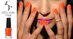 Love the orange polish next to that gorgeous pink lip
