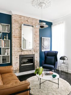 Narrow Terrace Renovation - An exposed brick chimney flanked by blue feature walls adds to the boutique hotel feel of this living room in a renovated narrow townhouse in inner-Sydney. Narrow Living Room, Living Room Green, My Living Room, Living Room Interior, Living Room Decor, Blue Feature Wall Living Room, Fireplace Feature Wall, Brick Feature Wall, Living Room With Fireplace