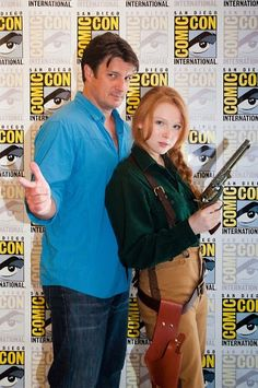 Comic Con 2012: Molly Quinn dressed as Mal standing with the captain himself, Nathan Fillion, who plays her father in Castle.