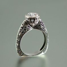 The WHITE COUNTESS Moissanite 14K white gold by WingedLion on Etsy, $2380.00 Classicly beautiful