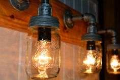 Rustic Mason Jar Vanity Light by reclaimerdesign on Etsy Rustic Mason Jars, Mason Jar Lamp, Basement Bathroom, Bathroom Stuff, Bathroom Remodeling, Bath Remodel, Vanity Lighting, Basin, Master Bath