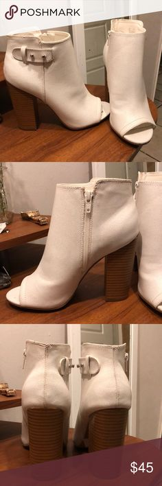 Rock and Republic White Booties In good condition. They were only worn when trying them on, sat on a shelf for some time. There is a crease on one of the shoes and a scuff on the back (as shown). Chunky heel makes them comfortable. Never wore them as I have a wide foot and fit too tight. Rock & Republic Shoes Ankle Boots & Booties