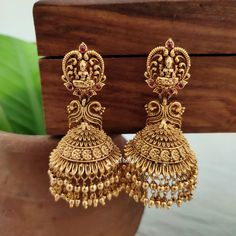 Chekc out this lovely imitation gold drops lakshmi temple jhumka earrings. Gold Temple Jewellery, Fancy Jewellery, Gold Jewellery Design, Gold Jewelry, Indian Gold Jewellery, Indian Wedding Jewelry, Ear Jewelry, Jewelry Bracelets, Gold Jhumka Earrings